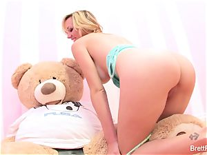 Brett Rossi plays with a inserted bear's strap-on dildo