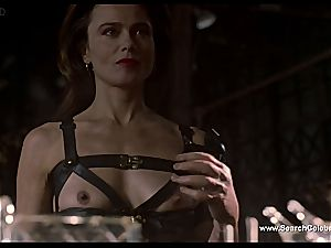 brown-haired Lena Olin in lingerie demonstrates off her puny boobies