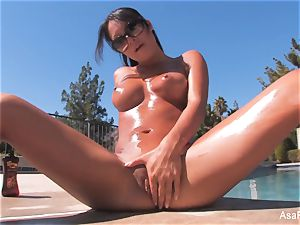 Everyone's dearest pornographic star Asa teases by the pool