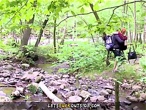petite redhead humped in the woods