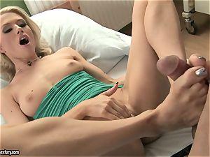 Michelle moist massaging a rock-hard pecker with her soles