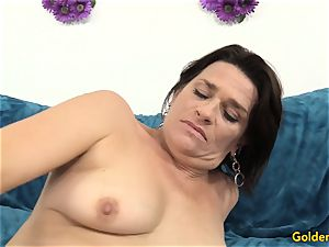 elderly milf pleases Herself with toys
